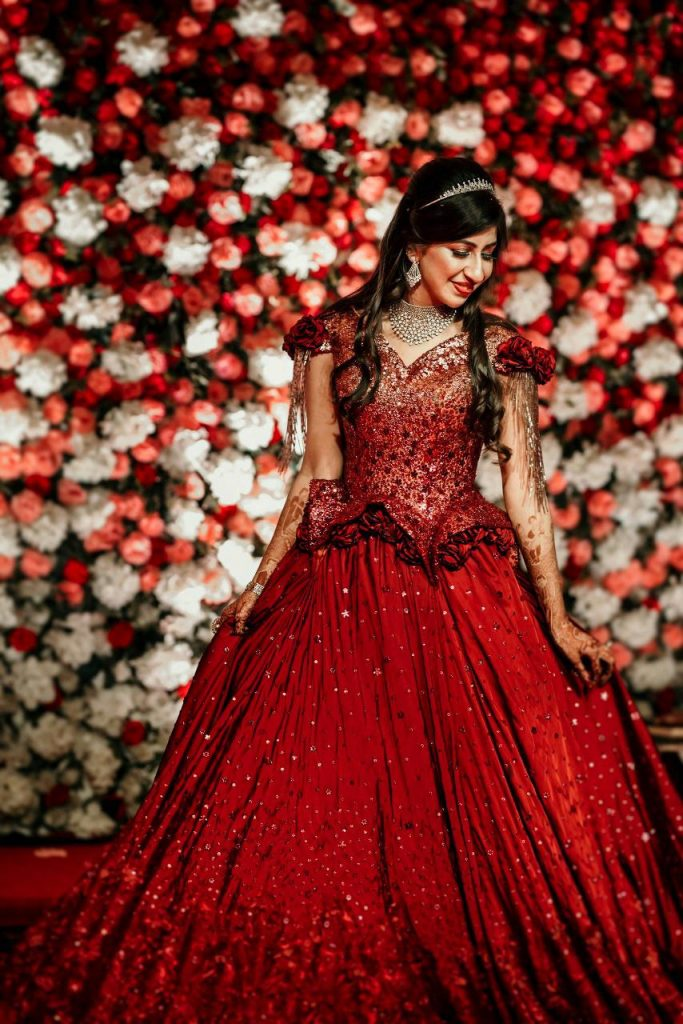 Delhi Wedding With A bride In designer red gown from designer Neeta Lulla