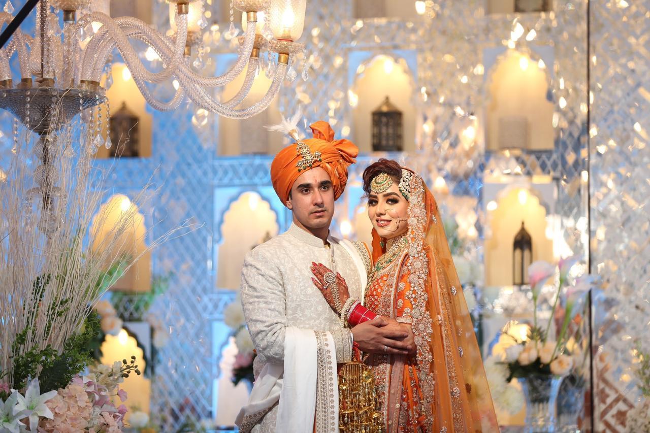 Chandigarh wedding with a bride in orange lehenga